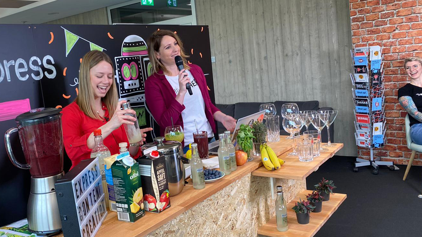 imc employees mix cocktails at product release party