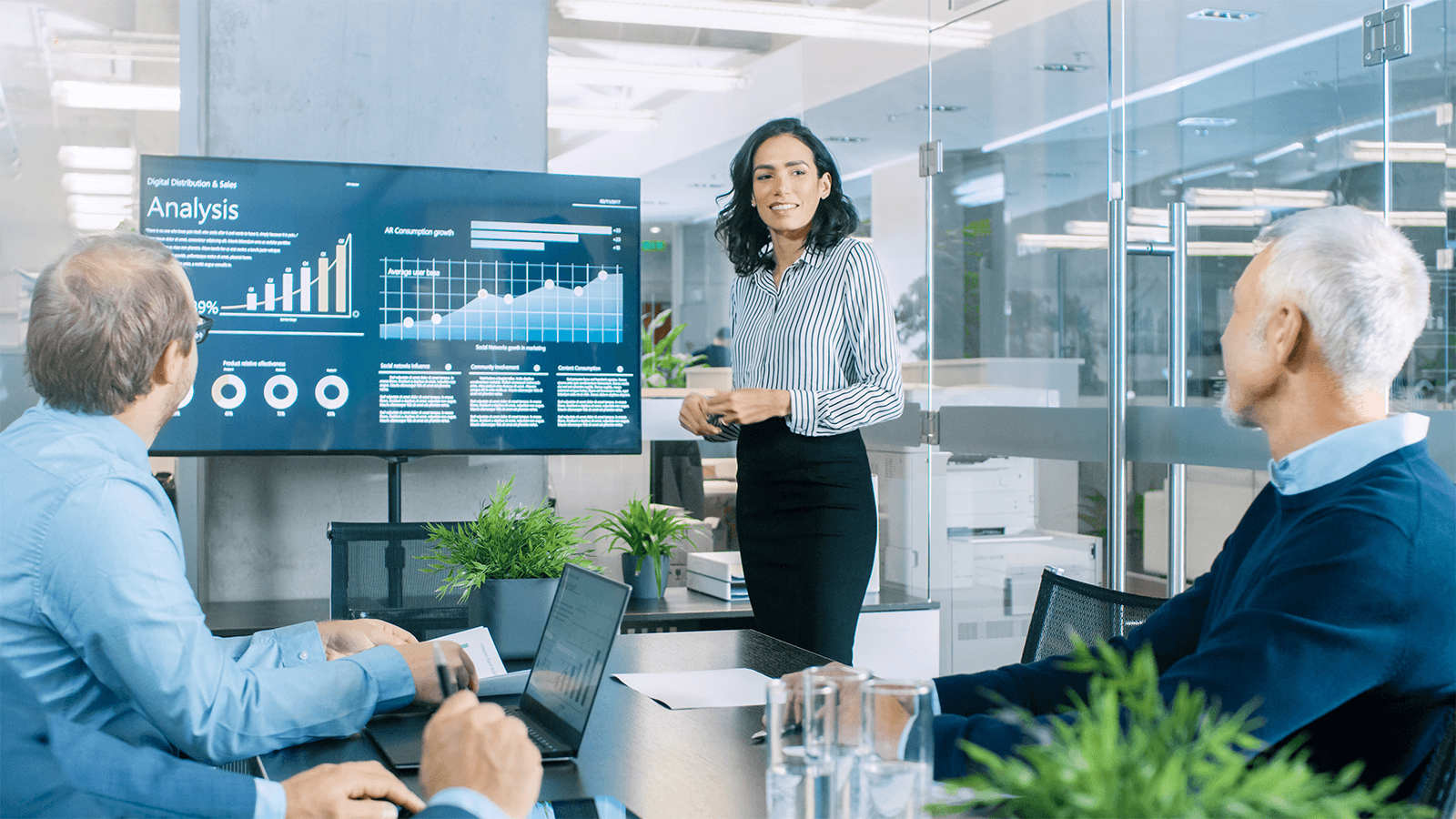 person presents analytics to colleagues