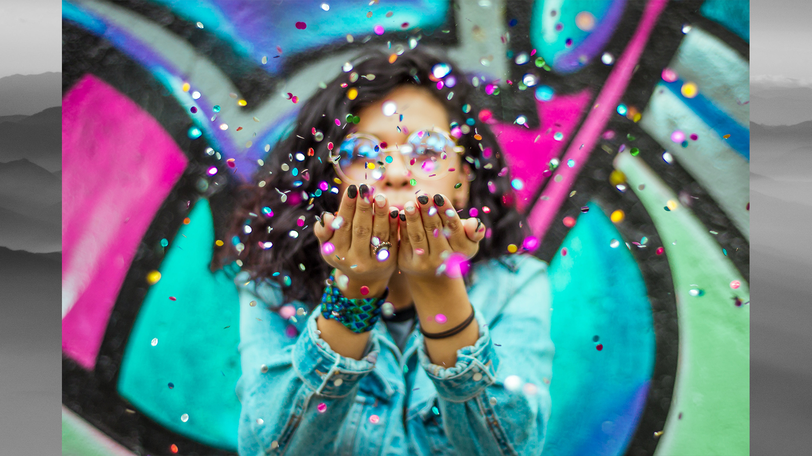 Young woman blowing confetti for Diversity Day